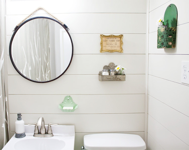 Transform your bathroom from dated to full of farmhouse charm in one weekend. Easy DIY farmhouse style bathroom makeover!