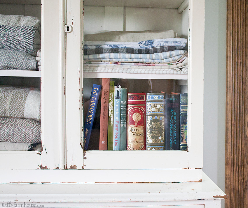 Use a charming old cabinet as a farmhouse linen cabinet
