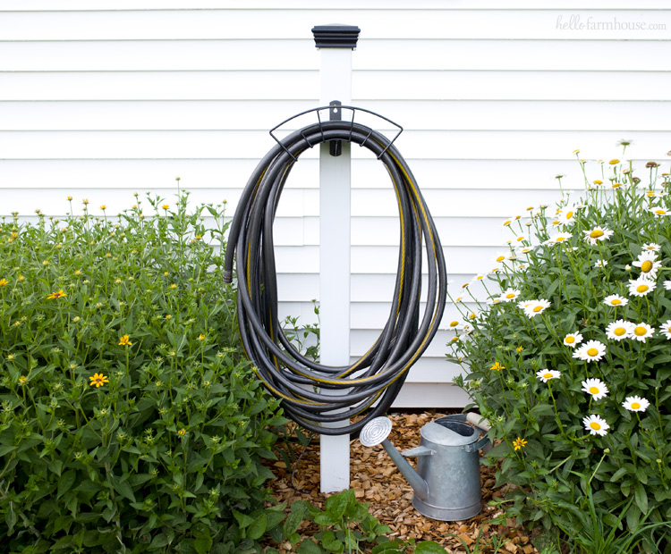 Keep your yard beautiful and organized with this super easy DIY hose stand project. It makes a huge difference and looks great in any landscaping!